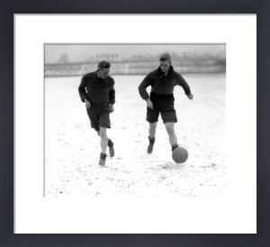 Bradford footballers train in snow, 1930s by Mirrorpix