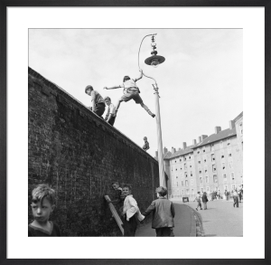 Climbing the wall, Oval cricket ground 1953 by Mirrorpix