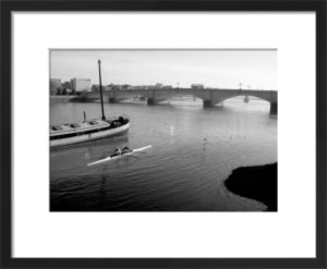 Scullers up to Putney Bridge by Niki Gorick