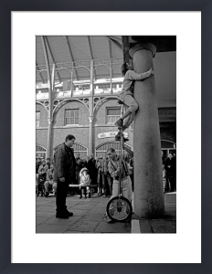Pearly Princess watches buskers, Covent Garden by Niki Gorick