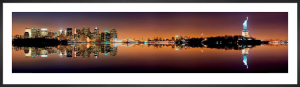 New York City Skyline with Statue of Liberty at Night by Songquan Deng