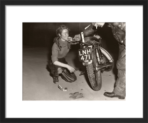 Girl with Triumph and roll-up by Anonymous