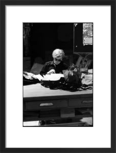 Andy at Typewriter, The Factory, NYC, circa 1965 by Nat Finkelstein