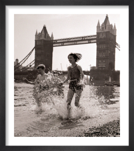 Children paddling on the foreshore below Tower Bridge by Mirrorpix