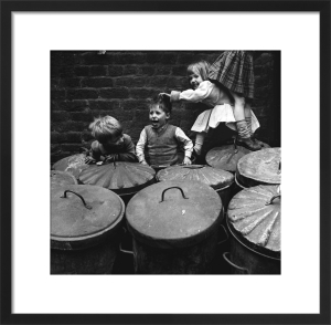 Children playing dustbins by Mirrorpix
