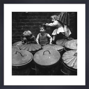 Children playing dustbins by Mirrorpix