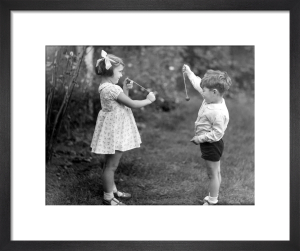 Young girl and boy playing conkers by Mirrorpix